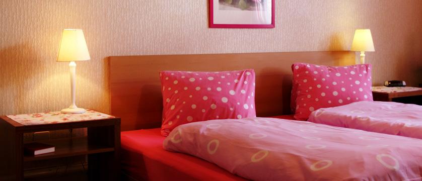 Hotel Alpina, Interlaken, Bernese Oberland, Switzerland - Bedroom.jpg